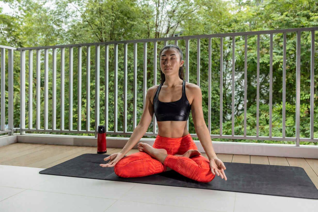 Asian woman yoga Balcony
